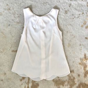 White Sleeveless Blouse with Gold Accents
